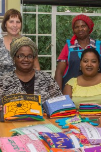 Book producers Lynette Rudman, Greanette Nguta, Margaret Mabindisa and Liyema Mabindisa display some of their work on Friday, April 4, 2014. Books are sold to schools for the blind both nationally and internationally.