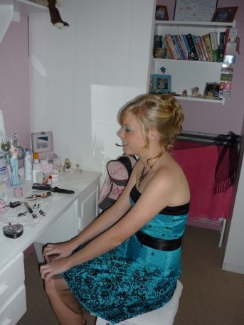 Sarah Kingon glances in the mirror before going to the Hoërskool Grens Matric Dance in August 2010.