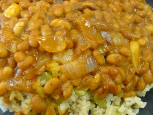 Despite the rice dish having to cater for both lunch and supper for the family of five, its contents of beans, rice and an onion almost doubled the R22 budget to make. (Photo: Eva Euijen)