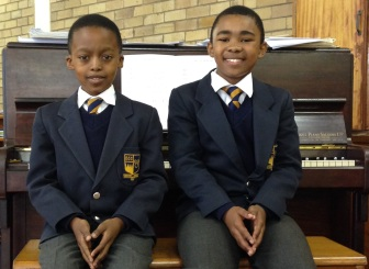 Graeme College Grade 6 learners Xolisa Foley and Bayanda Mthetho have been part of the Cathedral Choir for over a year and receive scholarsips towards their school fees as a result. Photo: Roxanne Daniels
