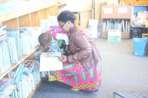 Pre-school learner...looks at a picture on a story book that her mother found for her in the library Picture: Ntombovuyo Ngaphu