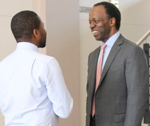 First Rand Ltd CEO (right) Sizwe Nxasana being welcomed to Rhodes by Black Management Forum Student Chapter provincial treasurer.  Photo: Roxanne Daniels